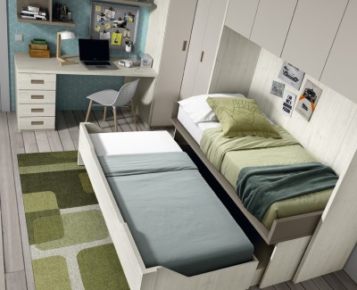 Children's bedroom comprised of single bed with trundle bed, desk and bridging unit