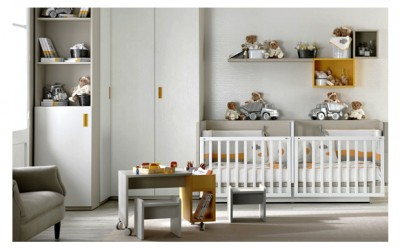 Baby's bedroom for twins with a convertible twin crib and a bunk bed's kit